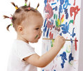Little Girl Paint On A Board Royalty Free Stock Photos - 8059388