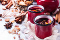 Hot Mulled Wine In A Red Mug For Winter Holidays Stock Images - 80541314