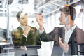 Two Businessmen Talking And Writing On Glass Board In Office Royalty Free Stock Image - 80552636