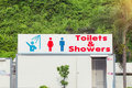 Sign Of Public Toilets And Shower For Women And Men. Public Toilets And Shower Royalty Free Stock Images - 80560819