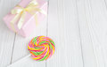 Rainbow Candy And Gift Box On Wooden Background Royalty Free Stock Photos - 80574808