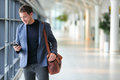 Business Man Using Mobile Phone App In Airport Stock Photography - 80594512