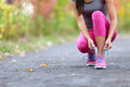 Running Shoes Woman Runner Tying Shoe Lace For Run Royalty Free Stock Photos - 80594688