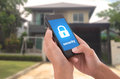 Hand Holding Mobile Phone With Concept Technology Home Security Stock Images - 80602484