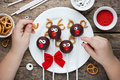 Child Decorate Festive Reindeer Cake Pops Cookies And Candy Royalty Free Stock Image - 80626976