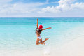 Happy Christmas Hat Girl Jumping Of Joy On Beach Royalty Free Stock Images - 80633249