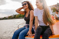 Friends Relaxing On Pedal Boat In Lake Stock Images - 80636064