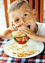Little Cute Boy 6 Years Old With Hamburger And French Fries Maki Royalty Free Stock Images - 80675729