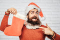 Christmas Man With Decorative Stocking Royalty Free Stock Photos - 80682058