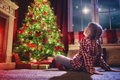 Girl Looking At Decorations The Christmas Tree. Stock Photography - 80690552