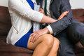 Man Touching Woman`s Knee - Sexual Harassment In Office Royalty Free Stock Photography - 80728837