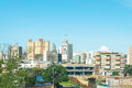Landscape Of The City Of Campo Grande. City With Some Buildings Between Trees, Car Traffic And Urban Art. Royalty Free Stock Photography - 80737037