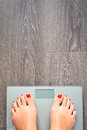 Help To Lose Kilograms With Woman Feet Stepping On A Weight Scale Stock Photography - 80760782