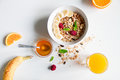Breakfast With Oatmeal And Orange Juice On White Background Royalty Free Stock Image - 80764226