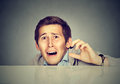 Funny Scared Man Peeking From Behind The Desk Stock Image - 80764561