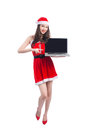Asian Christmas Girl With Santa Claus Clothes Holding Laptop Iso Stock Photo - 80775870