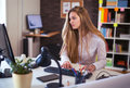 Portrait Of A Blonde Female Business Woman Sitting At Her  Desk Stock Images - 80814204
