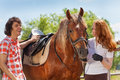 Young Couple Spending Time Together With Horse Royalty Free Stock Photo - 80819025