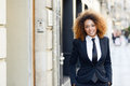 Black Businesswoman Wearing Suit And Tie In Urban Background Stock Photo - 80829200