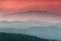 Landscape With Colorful Layers Of Mountains And Haze  Hills Covered By Forest. Stock Photography - 80831452