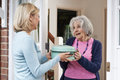 Woman Bringing Meal For Elderly Neighbour Royalty Free Stock Images - 80833609