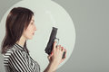 Woman With Gun Stock Images - 80841444