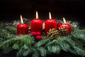 Advent Decoration Red Burning Candles Christmas Tree Branches Stock Photos - 80842933