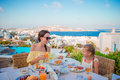 Family Having Breakfast At Outdoor Cafe With Amazing View. Adorable Girl And Mother Eating Croissant On Luxury Hotel Stock Photography - 80865712