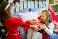 Two Girls Give Christmas Gifts Stock Photography - 80886432