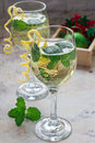 Spritzer Cocktail With White Wine, Mint And Ice, Decorated With Spiral Lemon Zest Stock Image - 80891821