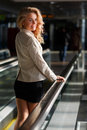 Beautiful Smiling Young Woman Looking Back While Standing On Travelator Stock Photos - 80914443