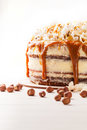 Cake With Hazelnuts And Homemade Salted Caramel. Close Up. Royalty Free Stock Photography - 80914847