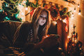 Portrait Of A Young Concentrated Woman Reading Comething Before Christmas Stock Photography - 80915792