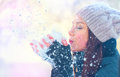 Winter Girl Blowing Snow In Frosty Winter Park Stock Photos - 80925323