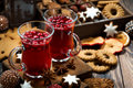 Christmas Hot Cranberry Tea And Cookies On Dark Table Stock Photo - 80955120