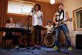 Multiracial Music Band Performing In A Recording Studio Royalty Free Stock Photos - 80963138