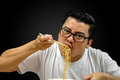 Asian Man Eating Instant Noodles Royalty Free Stock Photos - 80964728