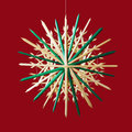 Straw Star Christmas Decoration Over Red Stock Images - 80965944