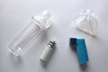 Cartridge And Blue Inhaler And Chamber And Mask Top Parts Stock Photo - 80990590