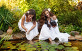 Sisters Draw Water From A Pond. Royalty Free Stock Image - 80997066