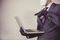 Business Man In White Mask Wearing Gloves And Using Computer - Fraud, Hacker, Theft, Cyber Crime Royalty Free Stock Photo - 81006475
