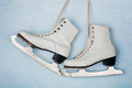 Vintage Ice Skates For Figure Skating Hanging On The Background Of Blue Wall. Stock Photo - 81012540