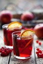 The Concept Of Homemade Mulled Wine. Sangria Or Punch With Orange, Apple And Berries In A Glass On Wooden Table. Stock Photo - 81014390