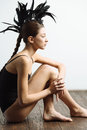 Young Sexy Mixed Race Caucasian Woman Vogue Portrait With Feather Mohawk Accessory Wearing Black Bodysuit. Royalty Free Stock Images - 81030469