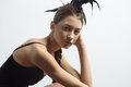 Young Sexy Mixed Race Caucasian Woman Vogue Portrait With Feather Mohawk Accessory Wearing Black Bodysuit. Royalty Free Stock Photography - 81030507