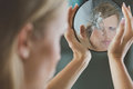 Woman Holding Small Broken Mirror Royalty Free Stock Photography - 81035427