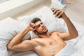 Puzzled Guy Using Mobile Phone After Sleep Royalty Free Stock Images - 81040079