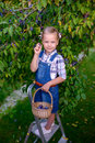 Funny Little Child Girl With Basket Full Of Plums Standing On Th Stock Photography - 81042462