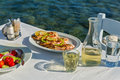 Table With Food And Wine Royalty Free Stock Images - 81044909