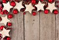 Christmas Corner Border With Rustic Wood Star Ornaments And Baubles Over Aged Wood Royalty Free Stock Images - 81047329